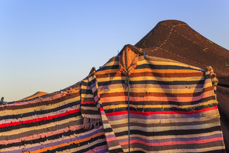closeup on Nomad tents made of camel skin with different colours