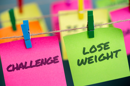 Closeup notes concept for motivation for challenge to lose weight Stock Photo