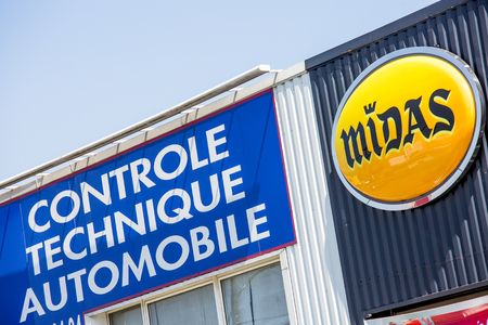 Argenteuil, France - April 23 2015: facade with Midas logo and words Automotive technical control (Controle technique automobile in French). Midas is company specialised in fast car repairing and maintenance