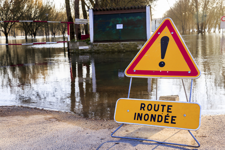 Closeup on warning sign of danger in front of a flooded road (Route inondee in French)