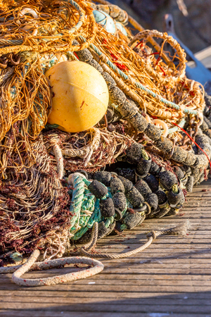 closeup on fishing nets spread out on the ground
