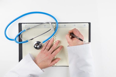 health professional taking an appointment on her agenda