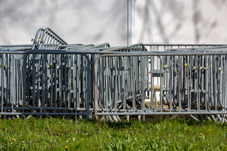 close up on metal barriers grouped on the grass