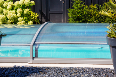 Close up on automatic retractable pool enclosure system to protect pool 写真素材