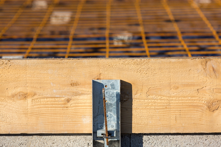 close-up of a wooden formwork with steel reinforcements for the preparation of the slab