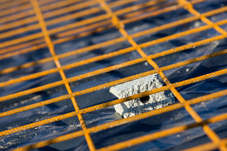 Close up on the metal structure of a slab on which the concrete has not yet been poured