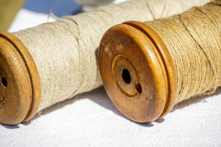 Closeup of brown jute twine roll on white cloth Stock Photo