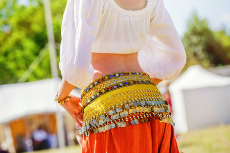 Close up shot of a belly dancer wearing typical arabic costume Stock Photo