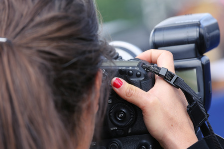 Close up of a professional photographer photographing a camera Stock Photo