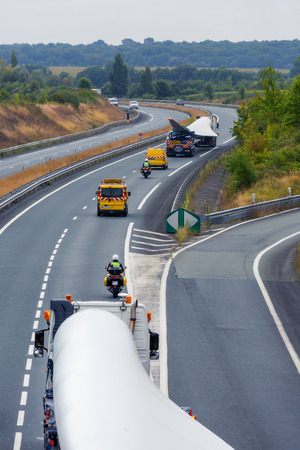 Benon, France - September 5, 2016: to view from above of an exceptional convoy truck (convoi exceptionnel in french) carrying a wind turbines propeller on a portion of national France.