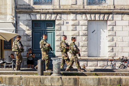 La Rochelle, France - August 22, 2016: French military patrolling the street of La Rochelle City to reinforce the vigipirate anti-terrorist plan.