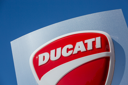 Puilboreau, France - August 7, 2016 : Closeup view of Ducati logo and sign board on blue pylon board outside showroom at Puilboreau, France. Ducati Motor Holding S.p.A. is the motorcycle-manufacturing 報道画像