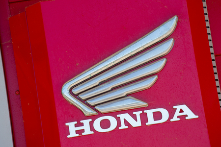 Puilboreau, France - August 7, 2016 : Honda text written in red with logo on exterior roof of distributor at Puilboreau, France. Honda Motor Company, Ltd. is a Japanese public multinational conglomerate corporation manufacturing automobiles, aircraft, mot Sajtókép