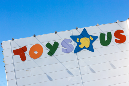 Puilboreau, France - August 7, 2016 : Toys R Us signboard on shop written in colorful alphabets against clear sky at Puilboreau, France
