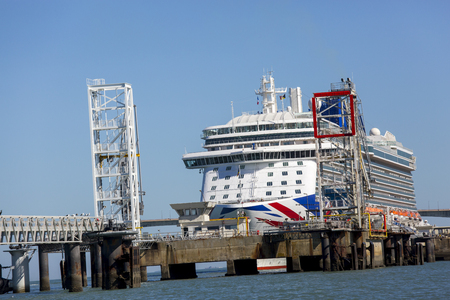 La rochelle, France - August 22, 2016 : Front view of Cruise ship, the Britannia by P & O Cruises anchored at the port of La rochelle, France. We can see cranes that are loading equipment and food.