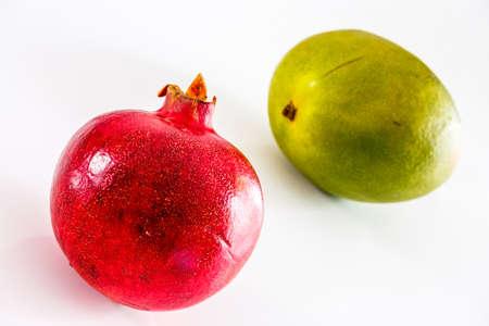 Exotics fruits Pomegranate and Lemon isolated on the white background