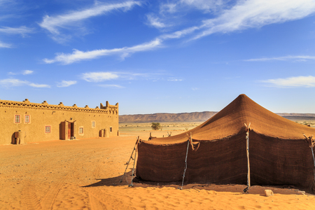 view of bedouin tent with clear blue sky above it 스톡 콘텐츠