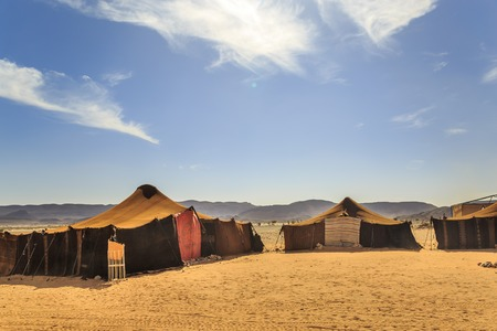 view of bedouin tent with clear blue sky above it Foto de archivo