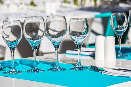 Close Up on collection of empty wine glasses and restaurant cutlery