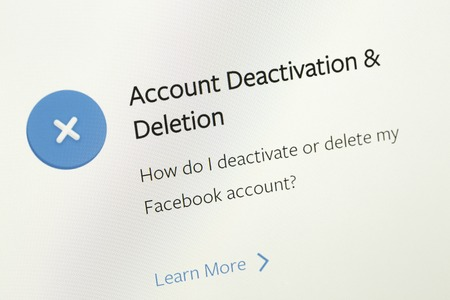 Houilles, France - April 10, 2018:Closeup on the FAQ area about desactivation or deletion facebook account with blue icon and link learn more. Editöryel