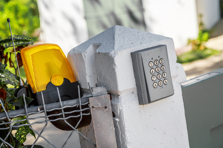 Automatic gate opening system and intercom access Stock Photo