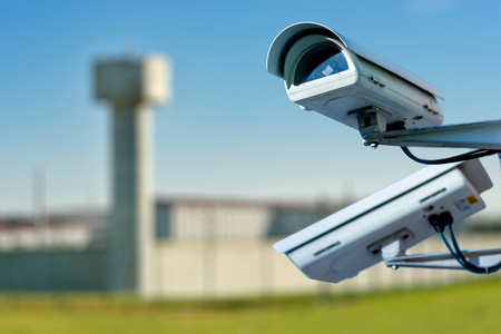 Focus on security CCTV camera or surveillance system with prison on blurry background