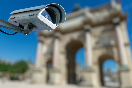 Focus on security CCTV camera or surveillance system with ancient monument on blurry background