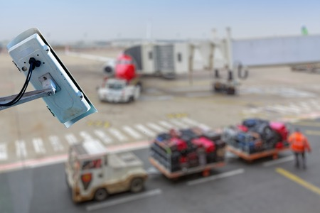 Focus on security CCTV camera or surveillance system with airport tarmac on blurry background Stock fotó - 102250082