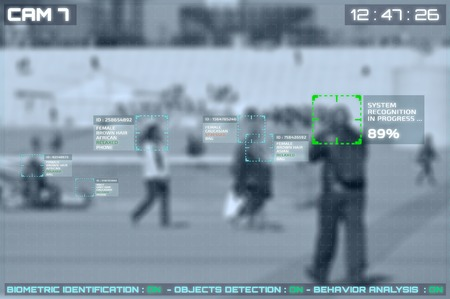 Simulation of a screen of cctv cameras with facial recognition on a large place in a city
