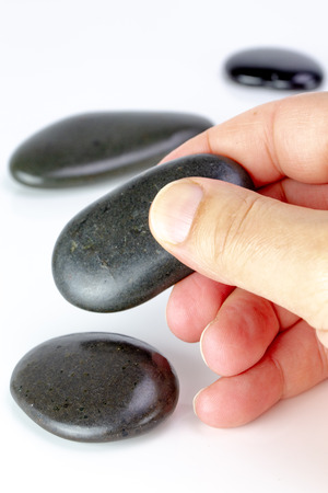 Zen Black pebbles on white background. Concept of business or positive concept
