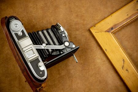 Top view of vintage camera and accessories on colorful background Stock Photo