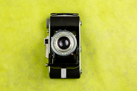 Top view of vintage camera on colorful background