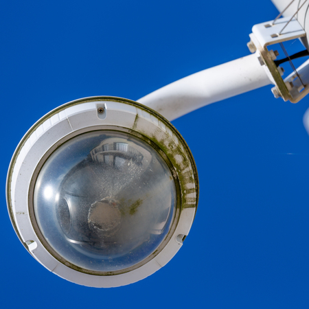 Closeup on CCTV camera under blue sky seaside for the safety of tourists