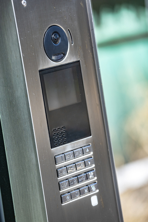 closeup on video intercom in the entry of building