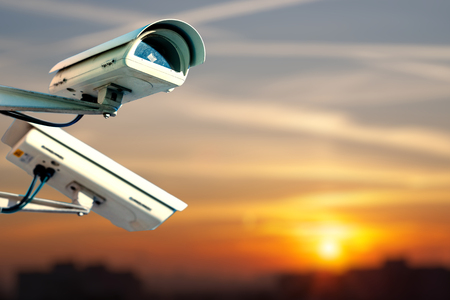 Modern CCTV camera on the city at the end of the day
