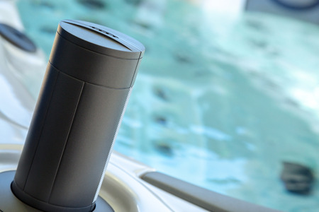 close-up of integrated music speaker on the edge of a therapeutic spa