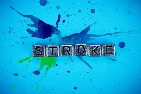 Stroke disease background concept represented by cubic metal letters