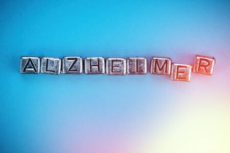 Alzheimer's disease background concept represented by cubic metal letters Stok Fotoğraf