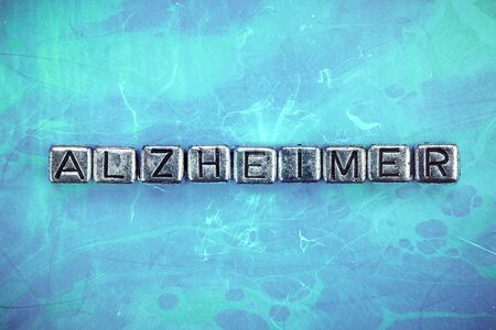 Alzheimer's disease background concept represented by cubic metal letters