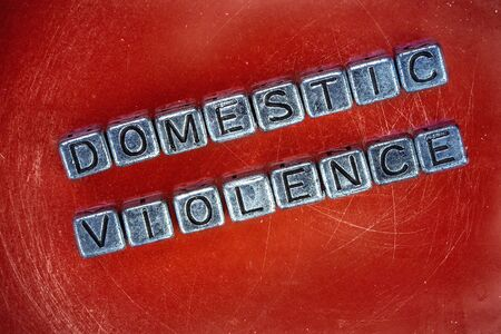 Domestric violence background concept represented by cubic metal letters Stock fotó - 133926546