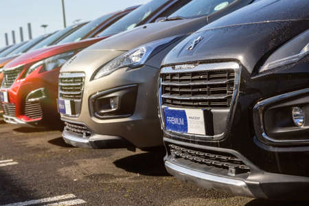 Cognac, France - February 21, 2020:Alignment of luxury second-hand cars for sale on the network of the French Peugeot car dealer