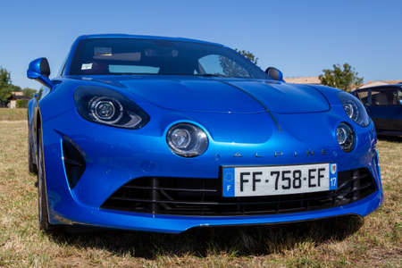 Benon, France - September 9, 2020: blue new Renault Alpine A110 car exhibited at the tour de france in small village contryside Editorial