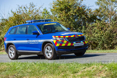 Benon, France - September 9, 2020: Gendarmerie patrol on a country road in escort during the tour de france cyclist