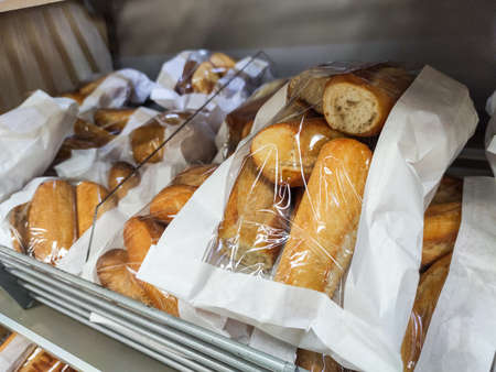 Puilboreau, France - October 14, 2020: Multitude of French bread baguete in the bakery section of a supermarket
