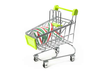 closeup on supermarket shopping cart isolated with a Italian tricolor ribbon, symbol of purchase of products made in Italy