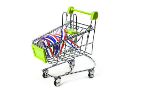 closeup on supermarket shopping cart isolated with a French tricolor ribbon, symbol of purchase of products made in France