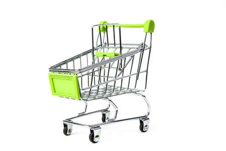 closeup on supermarket shopping cart isolated on white background Фото со стока