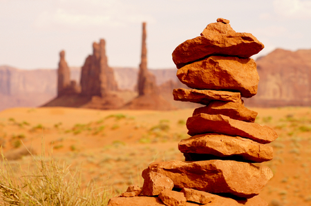Rocks balanced on each other with view on a hot american national park.