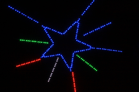 LED multi color set to show for star line shape,Red,Green,Blue and White  color that shine in front of black screen. Imagens