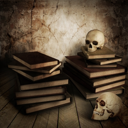 horrors: two ancient skull with lots of books Stock Photo